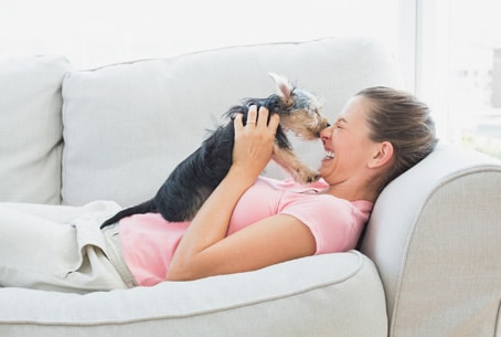 Woman happy playing with dog